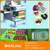 Fruit and vegetable tray cling film wrapping machine