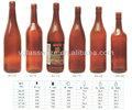de vidrio de cerveza de color ámbar con tapas de botella