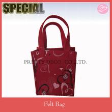 Offering cheap felt gift bag with heart patten