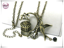 Burnish metal bird and bird cage charm dangle long necklace