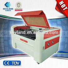 Caliente la venta del precio bajo CE ISO USB interfaz cnc co2 máquina de corte por láser / kevlar body armor