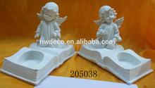 white resin angel with tealight holder