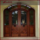 Elegant exterior housing wrought iron storm doors
