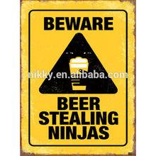 FUNNY VINTAGE TIN SIGNS, BEWARE BEER STEALING NINJAS INTERESTING METAL SIGN FOR SALE