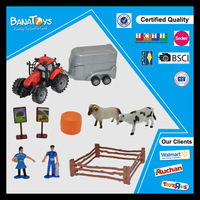 small plastic farm animal toy and small farm tractor