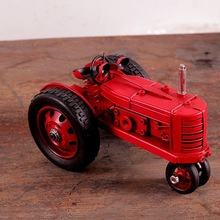 Antique red model tractor for cafe bar decorations