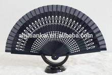Spanish wood fan in dark
