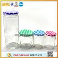 Clear glass jam jar with decorative lids