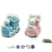 pink and blue funny baby shower cartoon train resin coin bank