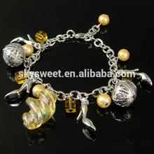 brass ball dangling conch bracelets,high heel bracelet, children beautiful bracelet