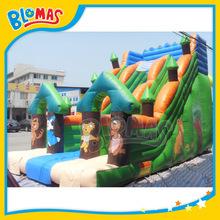 green happy inflatable slip n slide