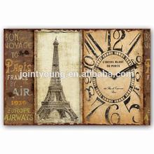 antique metal wall clock in eiffel tower design