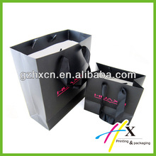 Guangzhou huaxin large capacity black paper bag for shopping and packing wholesale
