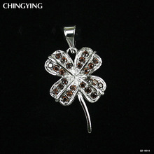 Four leaf clover with charming crystal pendant