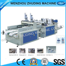 Heat sealing and cutting bag making machine