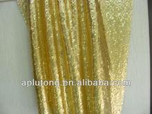 Bright and shiny golden sequins/Metallic sequin drapery