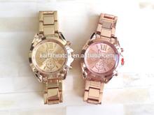 Geneva Platinum gold and rose gold sunray dial oversized bracelet watch