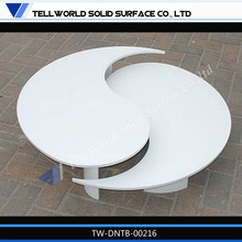 pure white solid surface dinning table in two cured parts