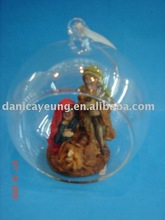 open glass ball with polyresin nativity set inside