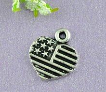 Pendants, American flag, zinc metal alloy, silver tone, 13x12mm. Sold per packet of 100