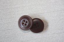 Brown button engraving laser