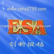 ,stamped badge,emblem,red letter pin badge