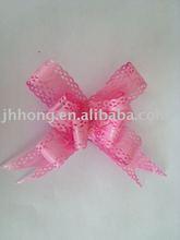 Polypropylene pull flower bow for gift wrap