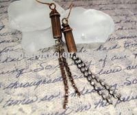 Earrings copper bullet casing with rhinestones
