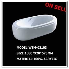 free standing acrylic oval bathtub with copper drainer