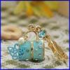 esmalte encanto llavero llavero con colgante bolsa de joyas de oro pendiente de la moda