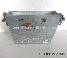Silvery zinc planter with rope