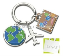 Metal key ring with global, aeroplane and luggage pandant
