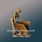Bronze statue of girl reading book