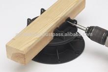 Deck installation on joists with adjustable pedestals