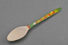 Wooden teaspoon with green handle