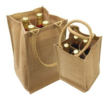 Eco-friendly 4 bottle jute wine bag. Made from natural organic jute and features cotton webbed handles. Comes with your logo.