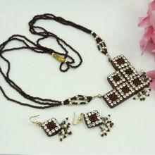 Silver and Red Crystal Studded Designer Square Lakh Pendant Set