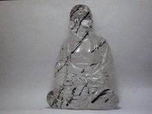 Quartz Buddha w/ black Tourmaline Needles