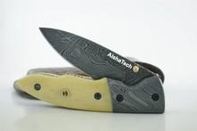 Couteau de poche en fabriqué à la main damas gravé lame en acier manche en os