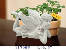 """H: 6-1/2"""" Polyresin fairy lying in antique white color"""