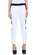 Long white slim pants with side stripped legs and low waist