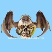 Polyresin decorative dragon with skull