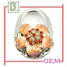 2011 Fashion New Design Flower Shaped Foldable bag hanger