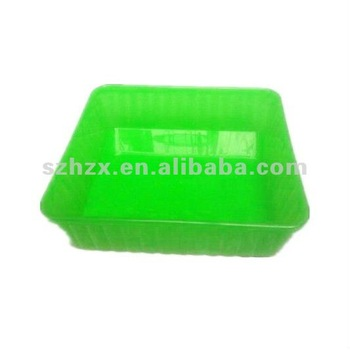 green square shaped plastic food tray