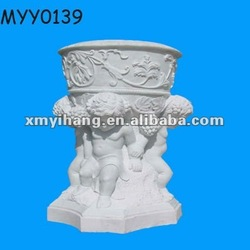 white ceramic flower pots with angels