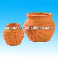 Sun face terracotta plant pots