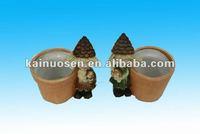 mini pine cone girl w/ terracotta pot wholesale