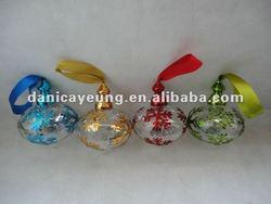 glass christmas onion with shinly snowflake