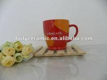 9 OZ red mug with gold design for nescafe brand