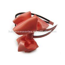 Big ribbon bows on double strand plastic Hair band